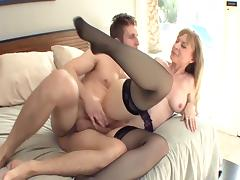 Big boobed blonde milf in stockings and a garter porn video