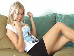 Beautiful babe with long legs masturbates at the sofa