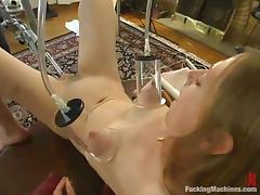 Fucking Machine Penetrating a Girl's Hairy Pussy Till She Cums