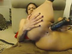 busty ebony toying with black toy