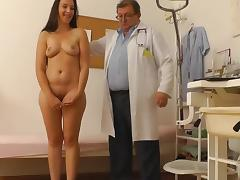Busty brunette gets some instruments in her puss