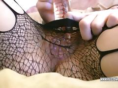 Megan Loxx in sexy stockings and fucking her dildo