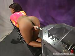 Ebony girl with huge boobs tests her new fucking machine