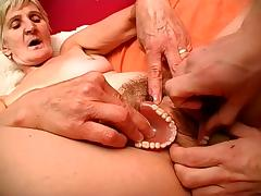 Blonde granny Irene plays with her artificial teeth while being fucked