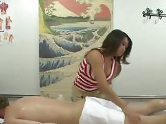 Asian girl with nice natural tits is working the cock during a massage