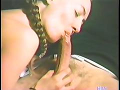 Pretty brunette babe sucks a dick in a retro video