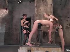 A slut gets tortured by two sexy bitches in a basement