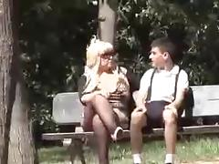 Busty granny & younger boy.