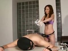 Asian babe fucks a guy with a strapon