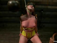 Naughty redhead slave gets twitched and hanged on legs