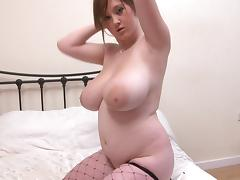 Young girl with big tits Malibu Candi posing in fishnet