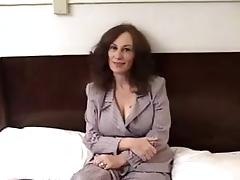 Mature woman with big boobs gets fucked in a bedroom