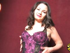 A gorgeous brunette in lingerie is fucking a gloryhole