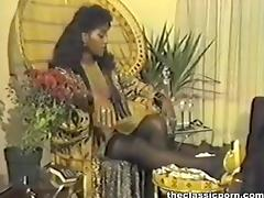 Retro black girl between white rods porn video
