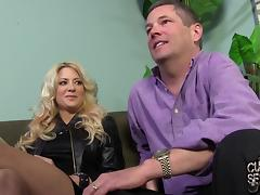 Blonde milf Helly Mae Hellfire lets a man play with her big fake tits