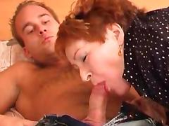 Redhead granny Zoy yo is sucking a nice dick