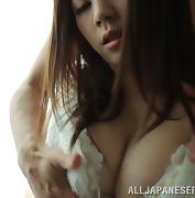 Busty Japanese babe Miki Torii enjoys ardent fingering