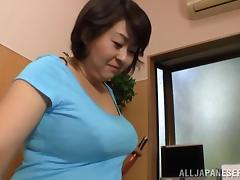 A fat Japanese woman gives a titjob and sucks a dick