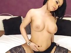 Busty MILF in stockings plays with her twat