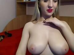 Curvy blonde masturbates hard on a webcam