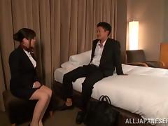 A Japanese stewardess has sex with some guy in a motel