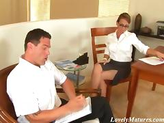 A superb office MILF gives a nice blowjob to her colleague