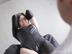 An Asian girl in a leather bodysuit gets nailed by two men