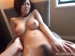 Japanese chick shows her awesome natural tits and rides a cock