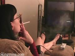 Brunette In Glasses Smoking Heavily In A Reality Shoot