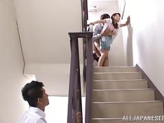 Asian MILF has Clothed Sex in the Middle of a Staircase