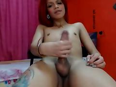 Red-haired skinny colombian shemale jerks off & cums