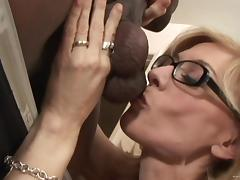 Blonde mom Nina Hartley wearing glasses enjoys interracial MMF sex