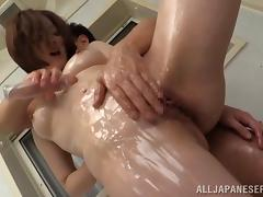 Hardcore Asian babe Yuuka Honjyou oiled up and fingered in shower