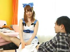Japanese girl wearing a costume plays with her BF's hard dick