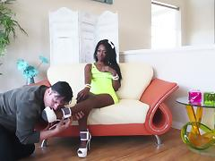 A white guy with a foot fetish bangs a sexy ebony babe