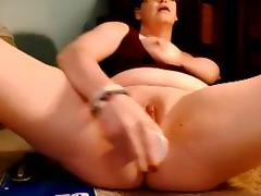 Glasses wearing Milf fucks pussy with toy