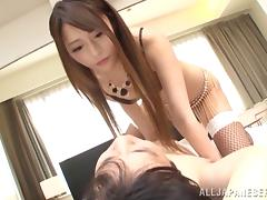 Rei Mizuna gives a footjob to a guy and takes a ride on his dick