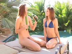 Raylene and Romi use a cucumber to fuck each other's assholes