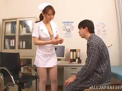 Adorable Asian nurse with big tits in uniform giving massive dick superb titjob
