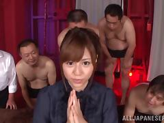 Alluring Asian dame in jeans giving massive dicks handjob in reality shoot