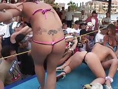 Bikini girl get naked doing lesbian things on stage at a party