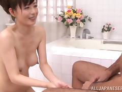 Attractive Asian dame with hot ass getting her hairy pussy fingered immensely
