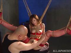Bound and hung up Japanese hottie gets her pussy toyed to orgasm