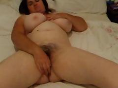 Busty chubby wife with hairy bush rubs her pussy