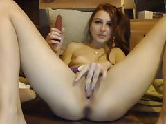 Girl rubs her clit while fucking her pussy with dildo